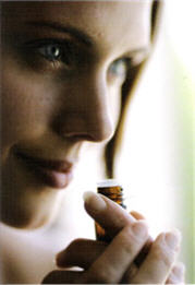 woman smelling oils